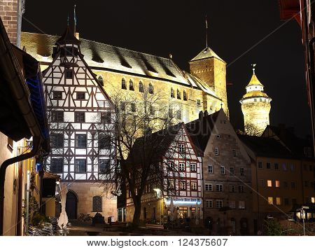 Nuremberg, Germany - March 21, 2016: The Castle and old houses seen from the medieval square at the Durer house at night