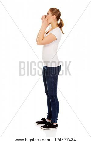 Young blonde woman calling someone