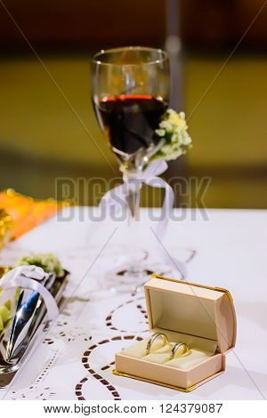 ATHENS GREECE - OCTOBER 25 2015: Wedding rings and chalice with wine on a table in preparation for a wedding at church Agia Fotini Ilissos church