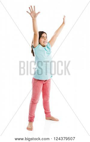 Studio portrait of a happy girl with arms raised on air