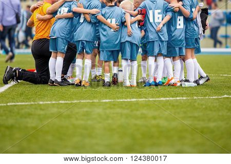 Young Boys In Soccer Football Team With Coach. Motivation Talk Before Soccer Match. League Soccer Boys Team.