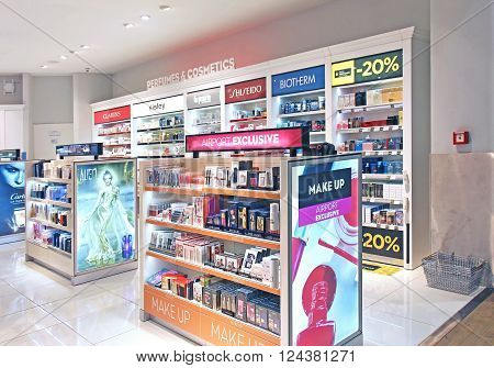 ROME ITALY - January 28: Duty free shop at Fiumicino International Airport with shelves full of make up and perfumes in Rome Italy - January 28 2016; Perfume and cosmetics are the most frequently bought products in airport duty free.