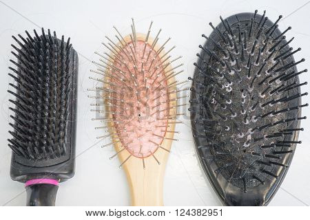 dirty, used hair brushes in flat lay