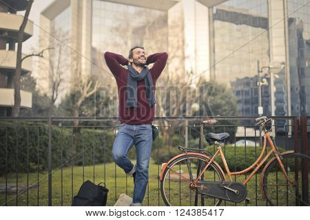 Happy guy relaxing outdoors