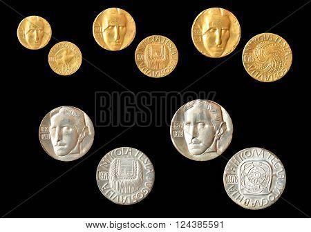 YUGOSLAVIA - CIRCA 1976 : Set of gold and silver medallions, made by Zlatara Majdanpek - Yugoslavia, that show portrait of scientist Nikola Tesla.