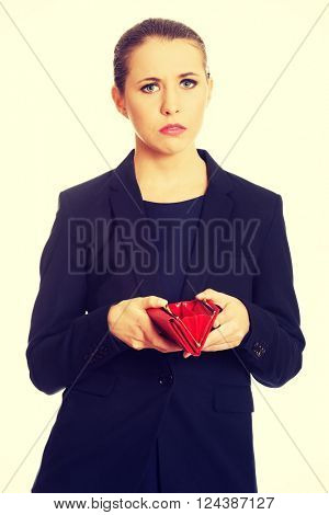 Upset businessswoman holding empty wallet