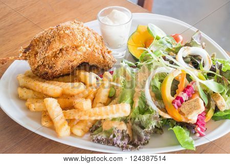 Deep fried chicken meat with organic salad stock photo