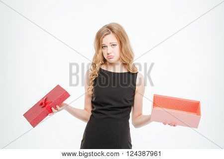 Sad woman holding empty gift box isolated on a white background