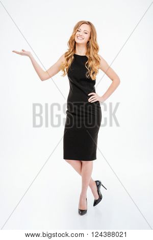 Full length portrait of a smiling woman holding copyspace on the palms isolated on a white background