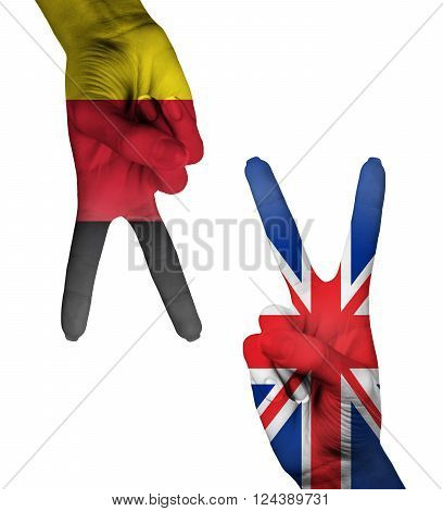 Hands making the V sign as symbol of victory. UK and Germany flag painted on hands isolated on white background