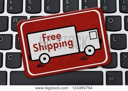 Free Shipping Sign A red sign with text Free Shipping on a truck on a keyboard