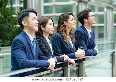 Business people look far away at outdoor