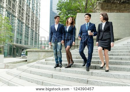 Group of business people walking down the stair