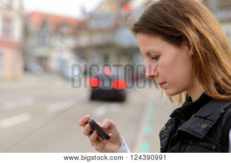 Young Woman Checking For Text Messages
