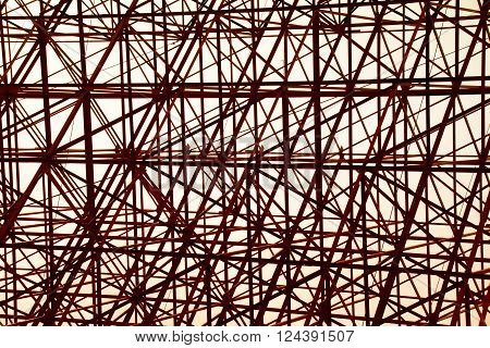 Structural orange steel cross construction abstract background