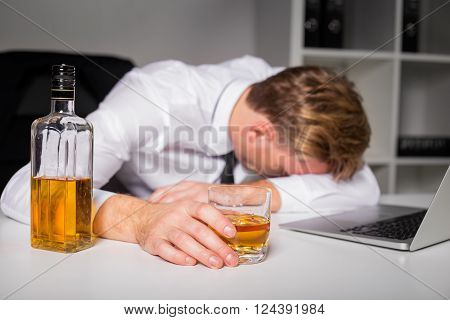 Drunk man at the office lying on the table