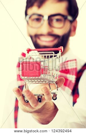 Man wearing suspenders with small shopping basket.