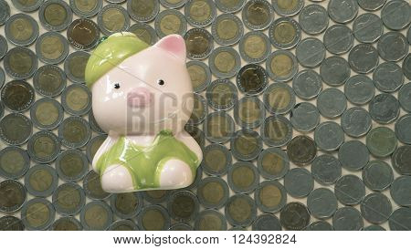 Piggy bank for saving coins and small change