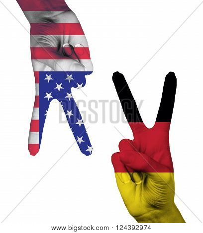 Hands making the V sign as symbol of victory. Germany and America flags painted on hands isolated on white background