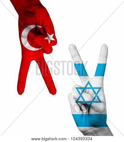Hands making the V sign as symbol of victory. Israel and Turkey flags painted on hands isolated on white background