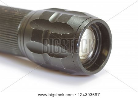 flashlight black color on white background closeup