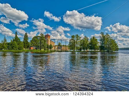 Lake view with reflections of Olavinlinna Olofsborg, the 15th-century medieval three-tower castle located in Savonlinna, Finland.