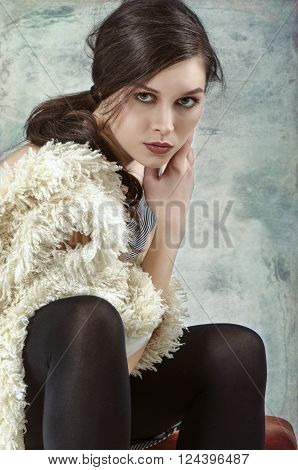 Fur Fashion.Beautiful Woman in Luxury Fur Coat against grungy background