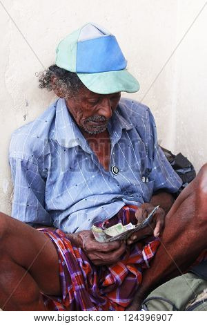 Colombo Sri Lanka - April 9 2011: Drunk old the beggar in the street on Sri Lanka