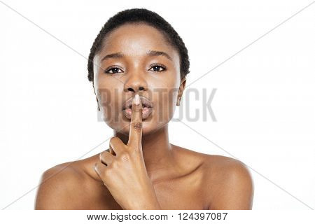 Afro american woman showing finger over lips isolated on a white background