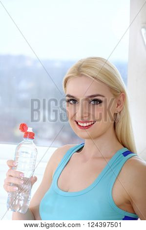 Woman Drinks Water From A Plastic Bottle.