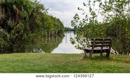 Old wooden long bench in the park