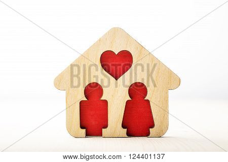 Little wooden house with couple inside of it