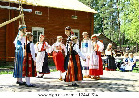 HELSINKI FINLAND - JUNE 20 2012: Unidentified dancers in folklore ensemble in traditional folk costumes at midsummer day festival