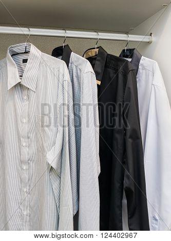 row of shirts hanging on coat hanger