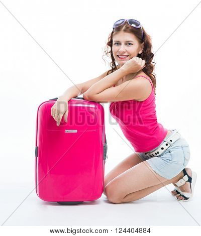 Girl with a suitcase going traveling on white background