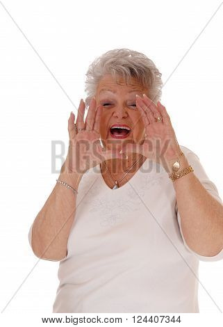 A gray haired senior citizen woman with her hands on her mouth