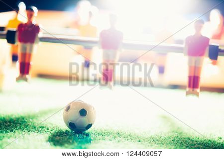 table football game, focus on the ball, backlight