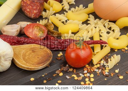 Ingredients for preparing pasta. Cooking pasta dishes. A traditional dish of pasta. Healthy diet meals.