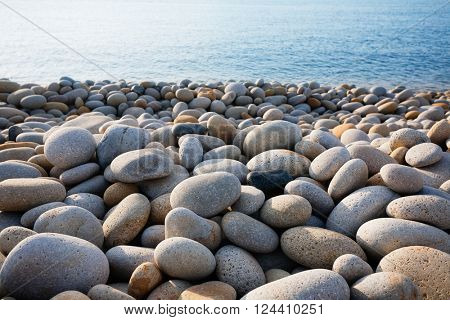 Seacoast pebble beach in the early morning
