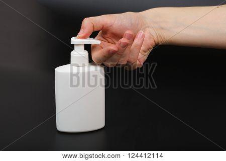 Liquid Soap Dispenser And A Human Hand