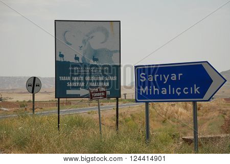 ANKARA/TURKEY-JULY 17, 2014: Signboard of Anatolian Mouflon protection area at the roadside of Ankara/Nallihan route. July 17, 2014-Ankara/Turkey