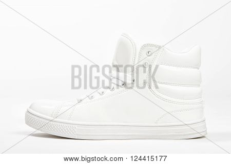 White sneakers on white background. Modern shoes