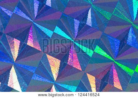 Blue psychedelic abstract formed by light reflecting off a textured metal surface