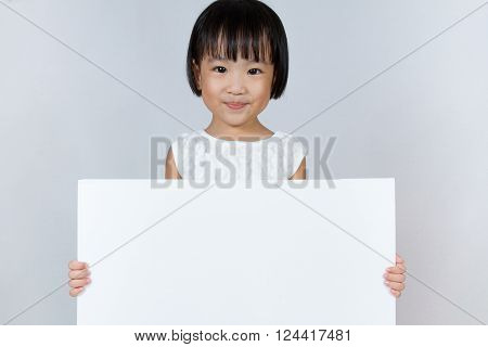 Asian Little Chinese Girl Holding A White Blank