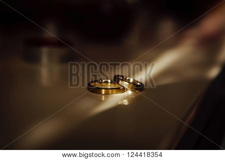 Two wedding rings laying on the table