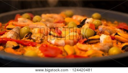 Paella, tasty spanish tradicional rice based elaborated dish