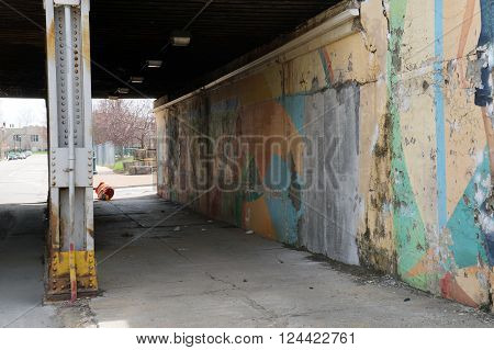 JOLIET, ILLINOIS / UNITED STATES - APRIL 12, 2015: Pedestrians may walk through the Clinton Street Viaduct in downtown Joliet.