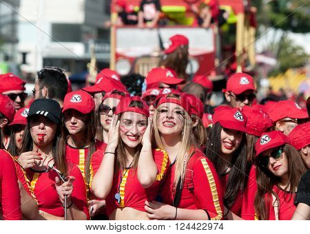 LIMASSOL CYPRUS - MARCH 13 :Group of Happy teenage girls dressed in red costumes at famous Limassol Carnival Parade on March 13 2016 in Limassol town Cyprus.
