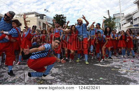 LIMASSOL CYPRUS - MARCH 13: Happy people in teams dressed with colorfull costumes at famous Limassol Carnival Parade on March 13 2016 in Limassol town Cyprus.