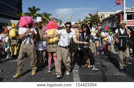 LIMASSOL CYPRUS - MARCH 13 : Happy people in teams dressed with colorfull costumes at famous Limassol Carnival Parade on March 13 2016 in Limassol town Cyprus.